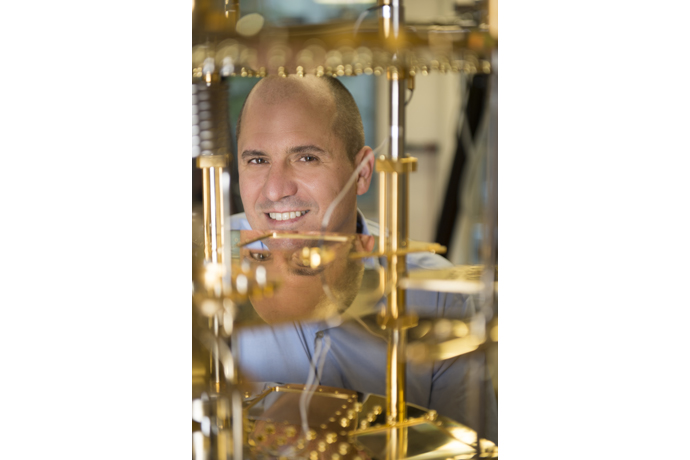 Professor Leo DiCarlo poses in the quantum computing lab at QuTe