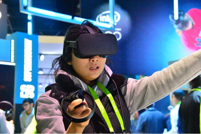A visitor to Intel's 2018 CES booth tries out a virtual reality