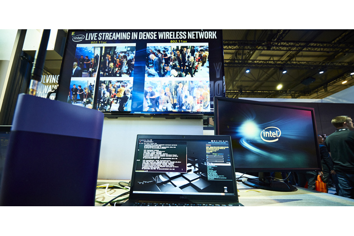 Visitors to Intel's Mobile World Congress booth on Tuesday, Feb.