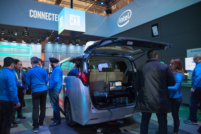 Visitors to Intel's booth at Mobile World Congress on Tuesday, F