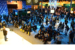 Visitors gather around the spotlight theater stage in Intel's