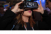 A visitor uses a virtual reality headset during a tour Intel's b